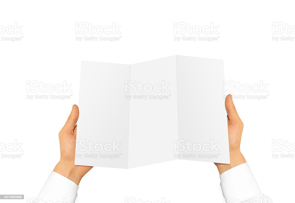 Hand holding blank brochure booklet in the hand. Leaflet presentation stock photo