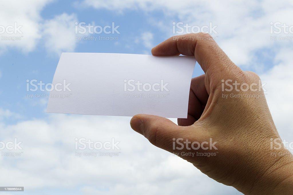 Hand holding blank card stock photo