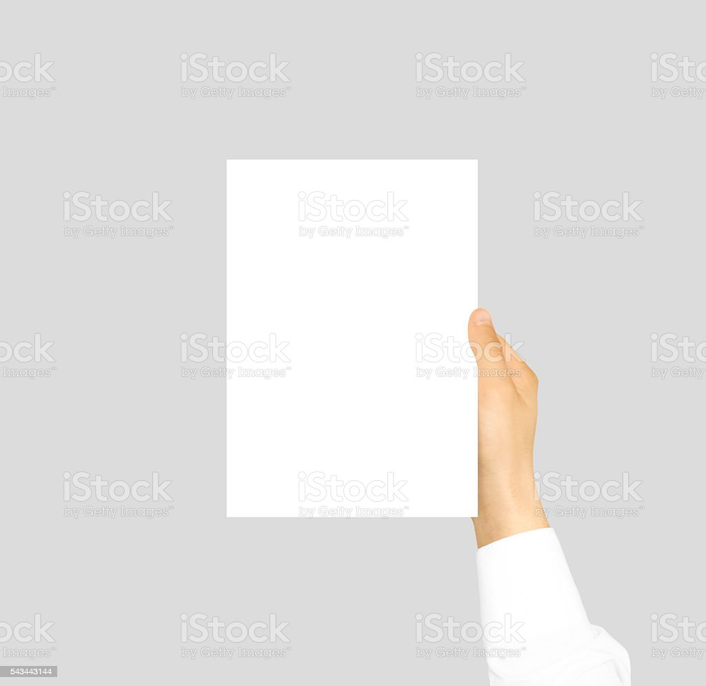 Hand holding blank flyer brochure booklet stock photo