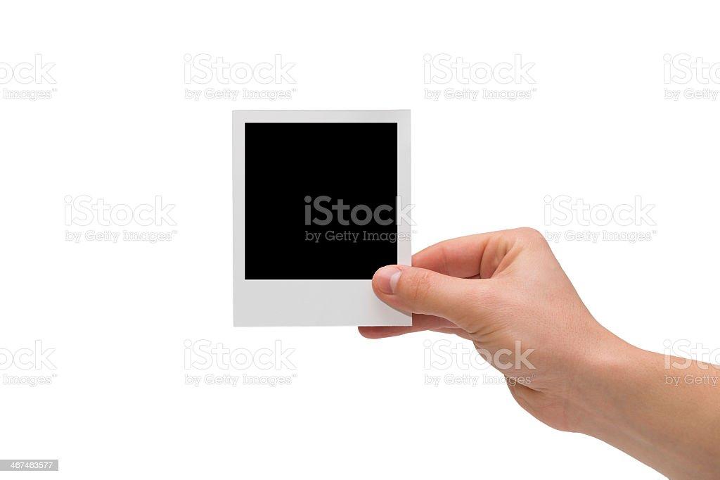 Hand holding blank instant photo stock photo