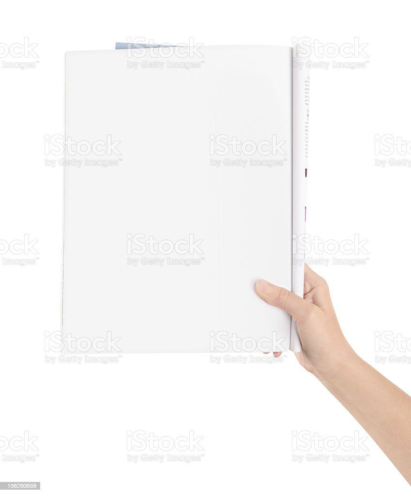 Hand holding blank magazine page stock photo