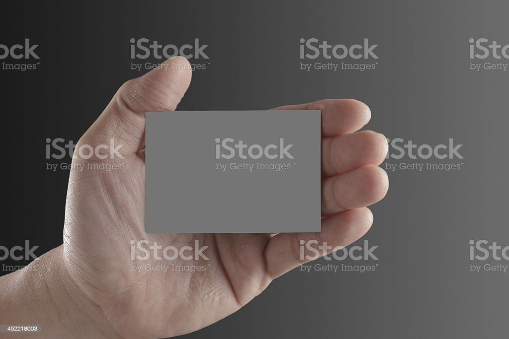 hand holding blank paper business card royalty-free stock photo