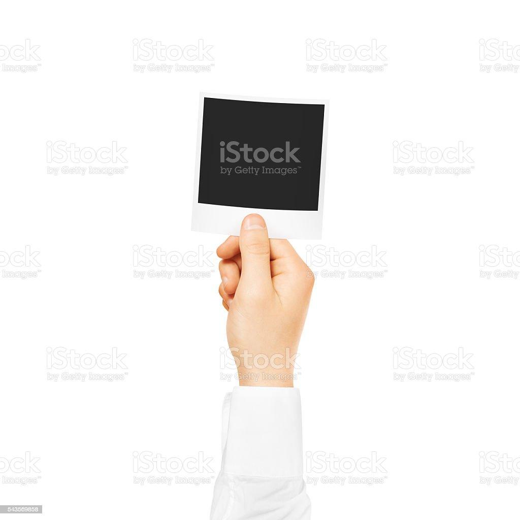 Hand holding blank photo frame mockup. Empty old photography stock photo