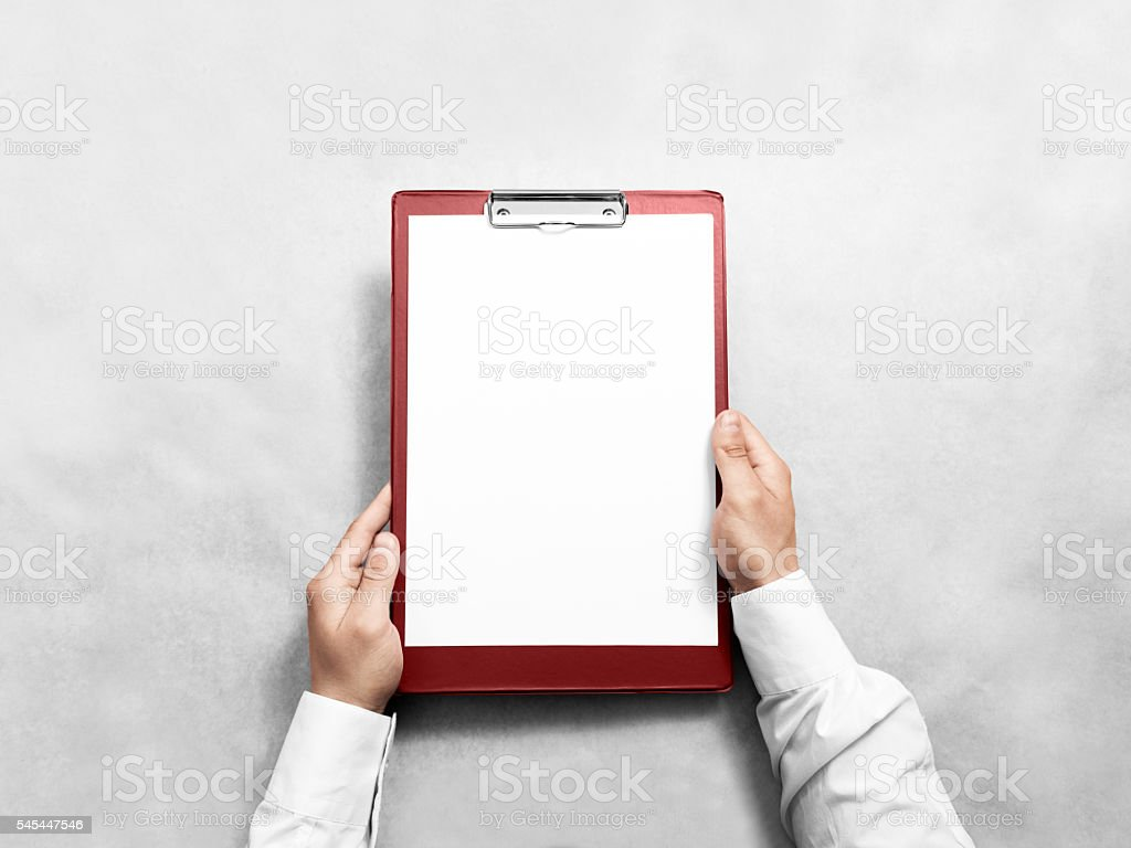 Hand holding blank red clipboard with white paper design mockup stock photo