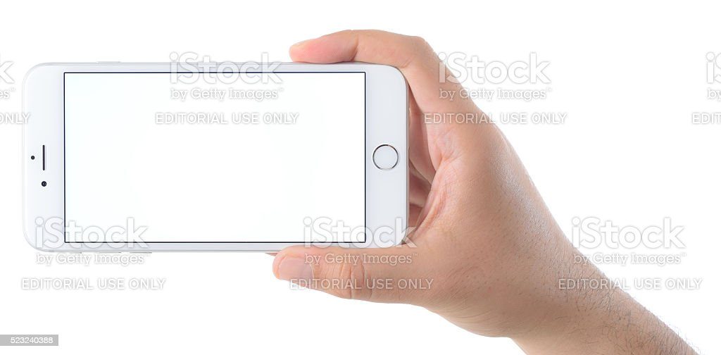 Hand holding blank screen iPhone 6 Plus stock photo