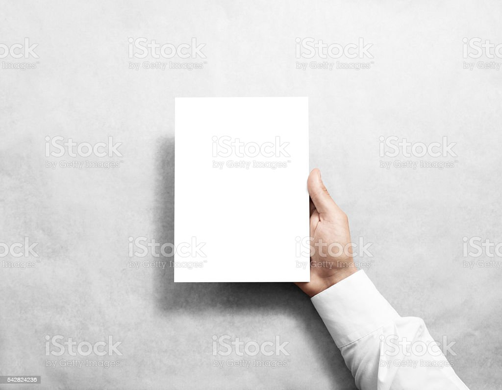 Hand holding blank white brochure booklet stock photo
