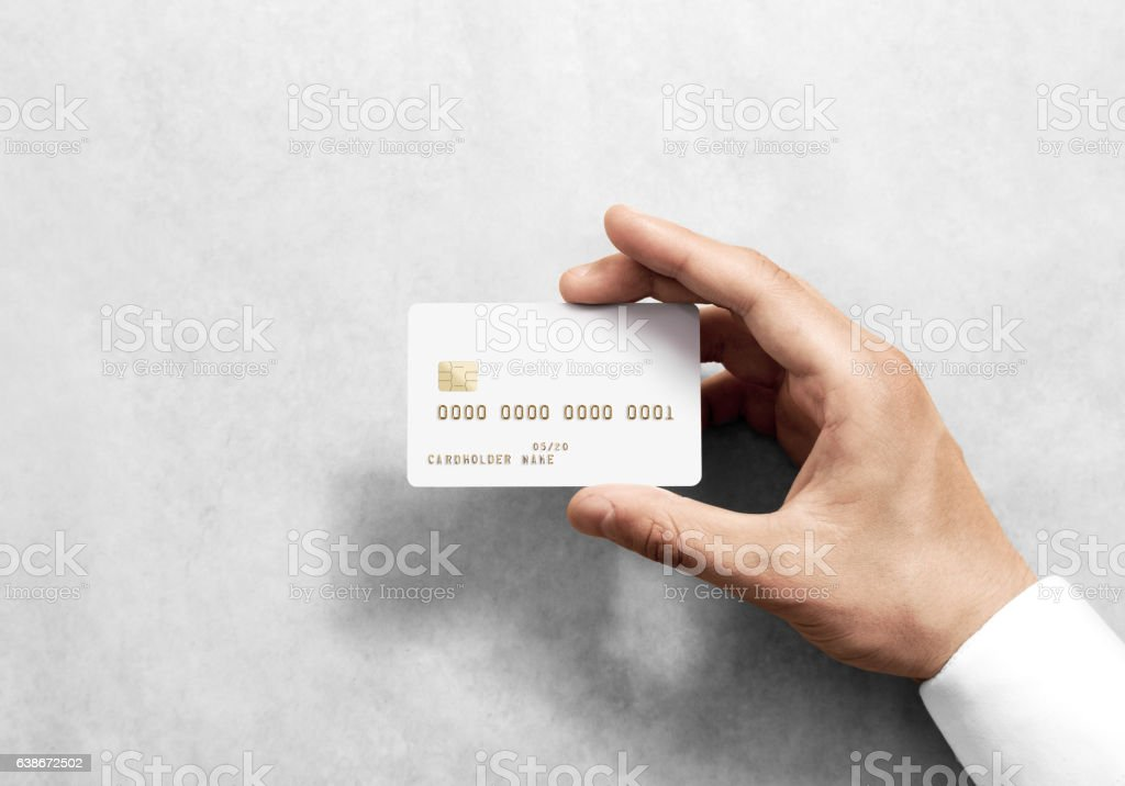 Hand holding blank white credit card mockup with chip stock photo