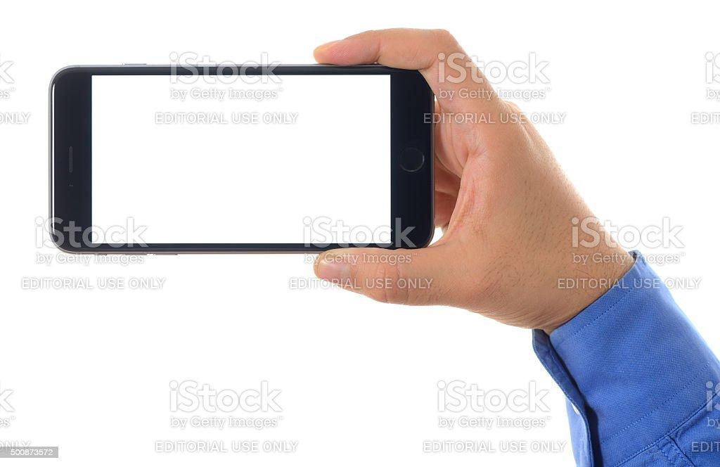 Hand Holding blank white screen Apple iPhone 6 Plus stock photo