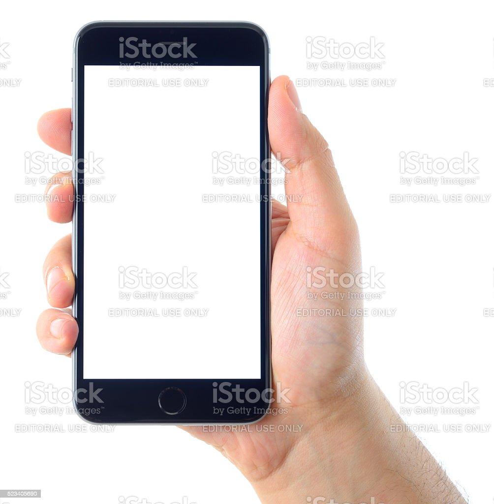 Hand holding blank white screen iPhone 6 Plus stock photo