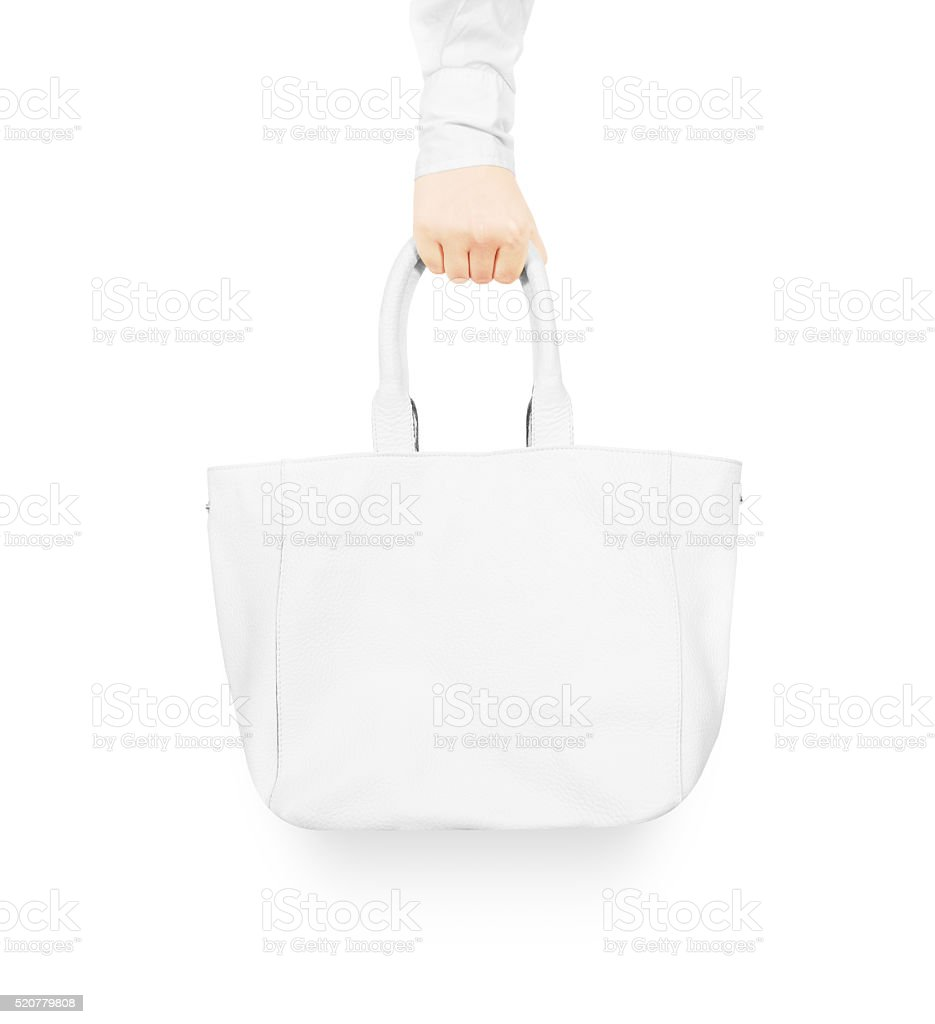 Hand holding blank white women's leather bag mock up stock photo
