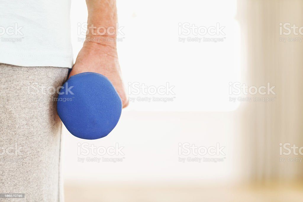 Hand Holding Blue Dumbbell royalty-free stock photo