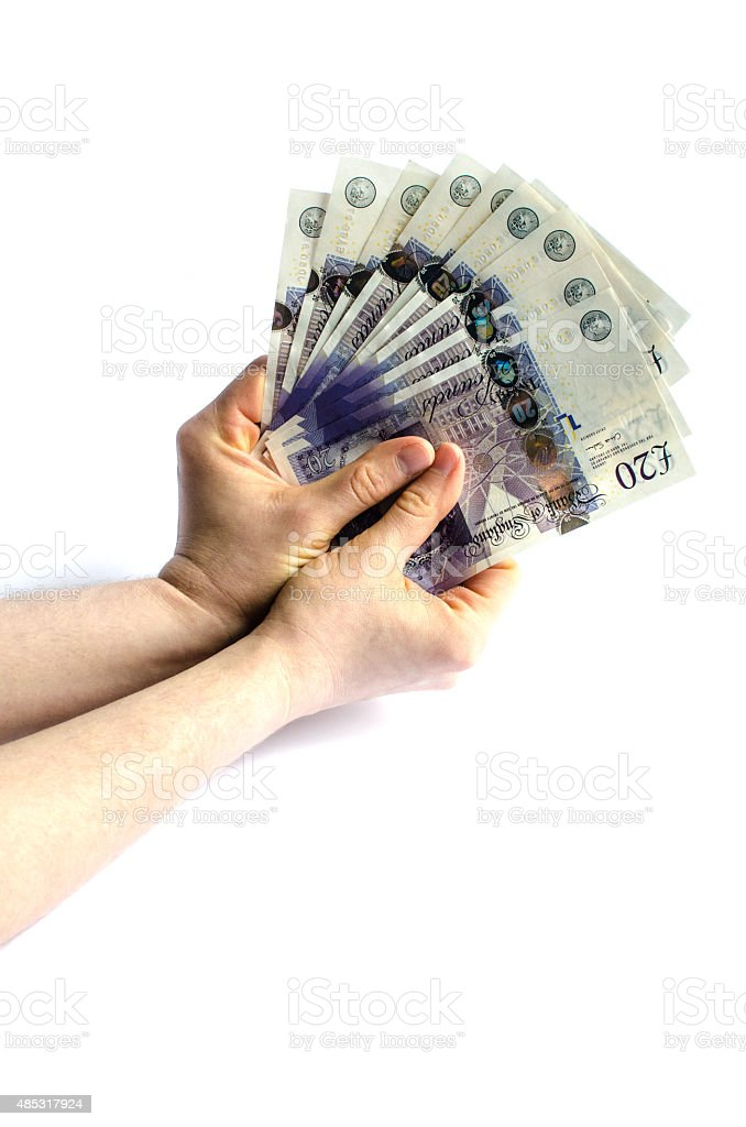 Hand holding British pounds stock photo