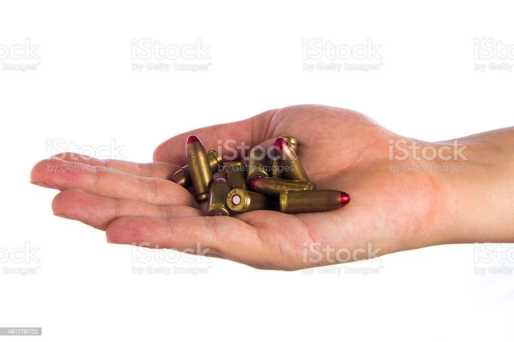 Hand Holding bullets stock photo