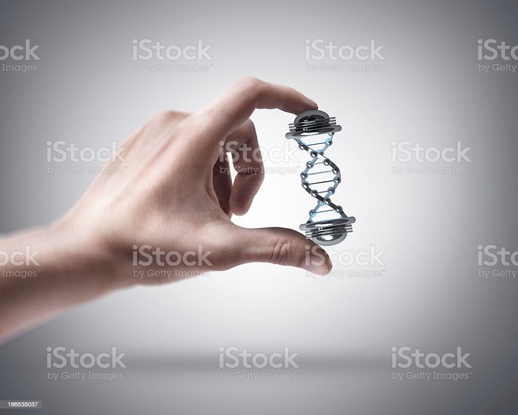 hand holding capsule with Sample DNA stock photo