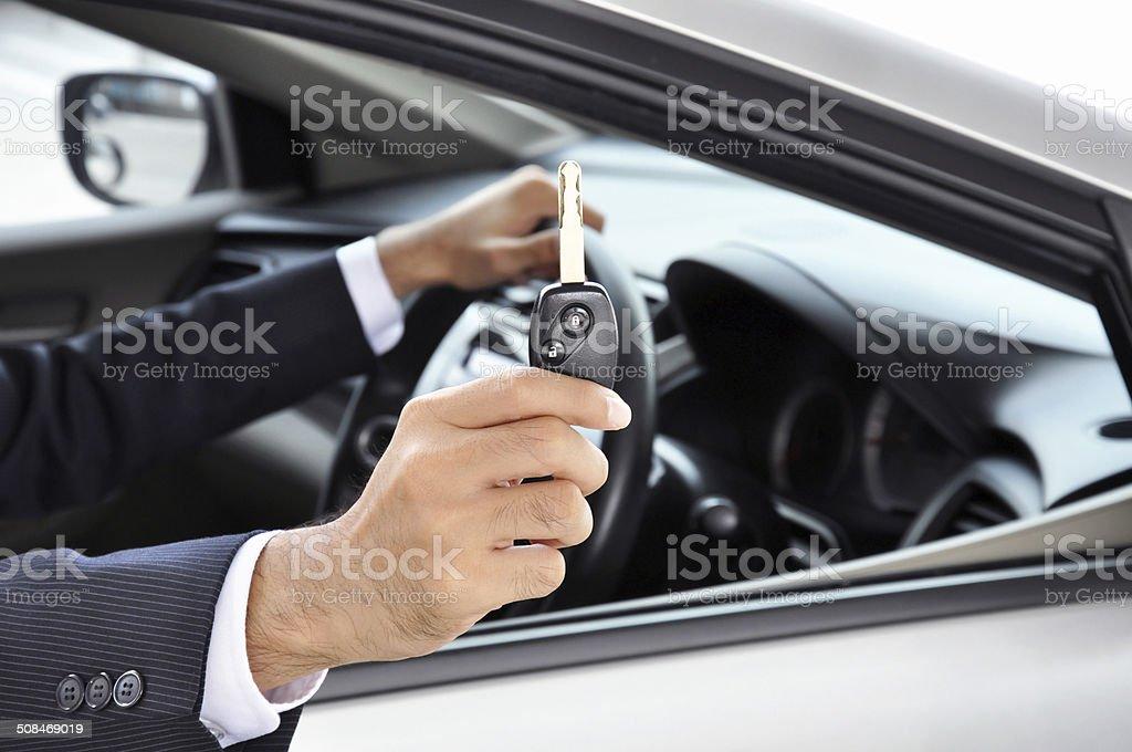 Hand holding car key - car sale & rental concept stock photo
