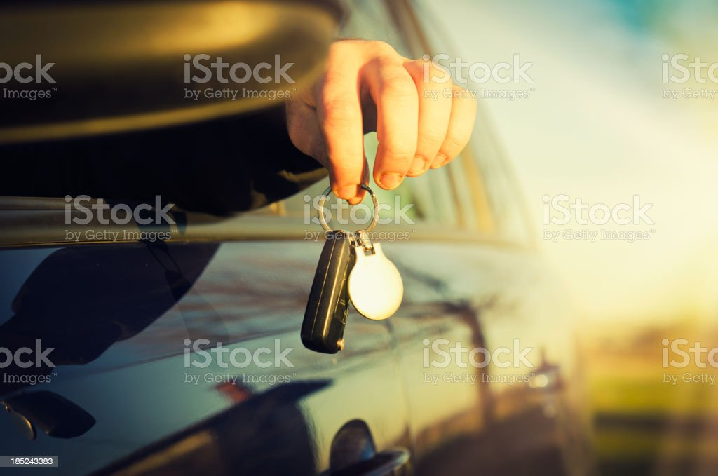 Hand Holding Car Key stock photo