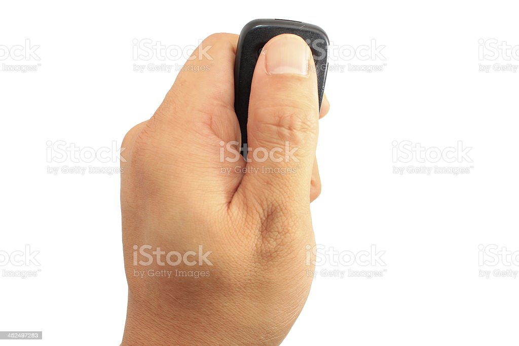 Hand holding car remote stock photo