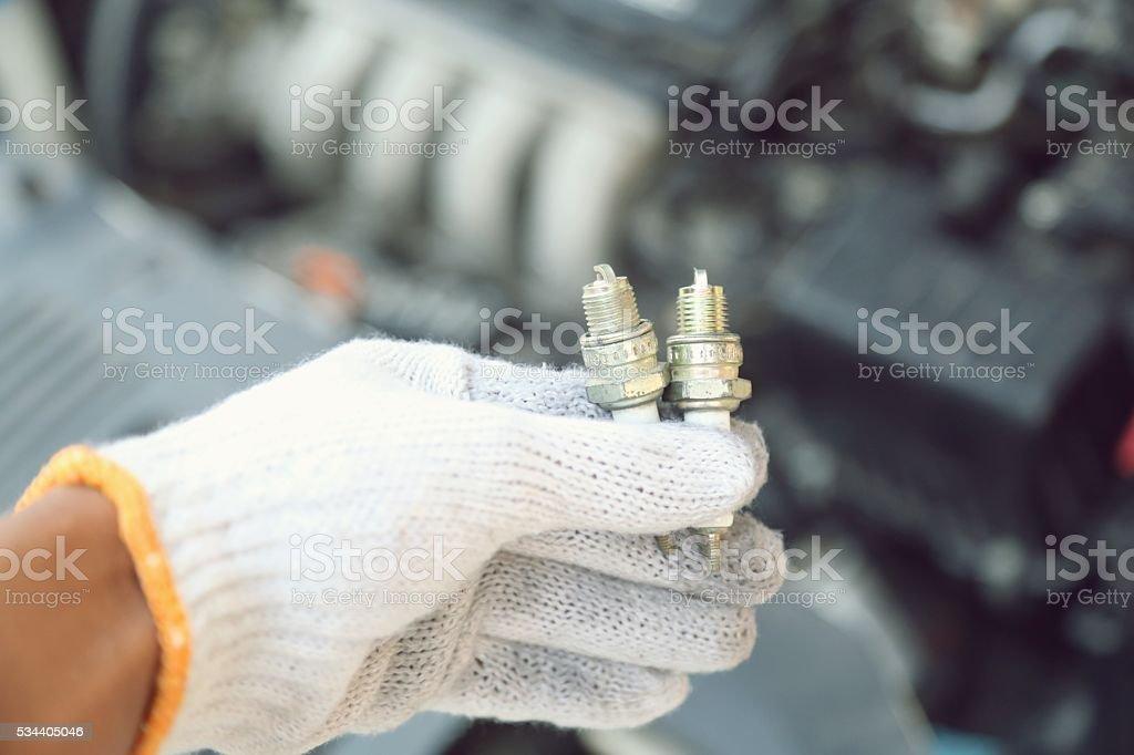 hand holding car repair tools in garage