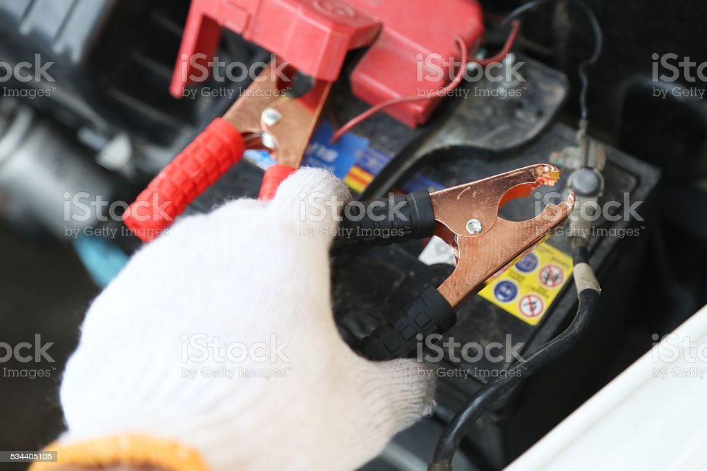 hand holding car repair tools stock photo
