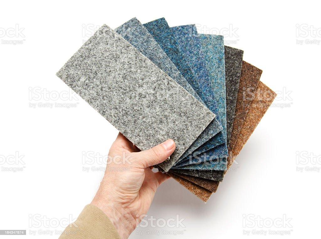 Hand holding carpet samples stock photo
