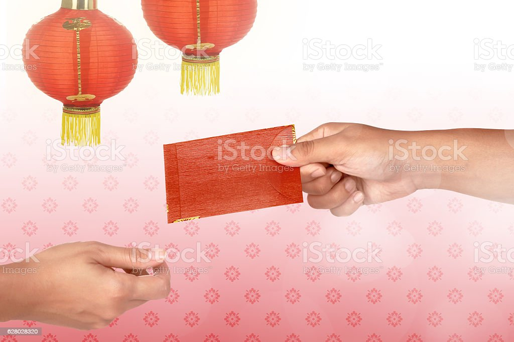 Hand holding chinese red envelope stock photo