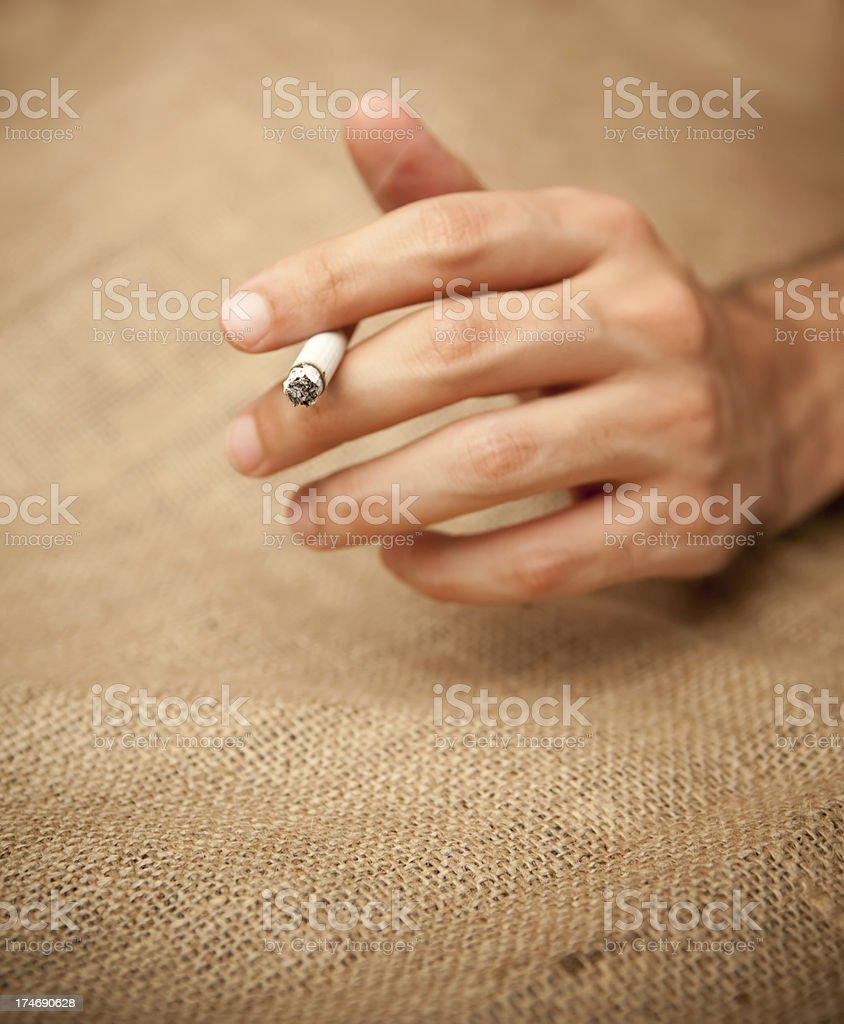 Hand holding cigarette royalty-free stock photo