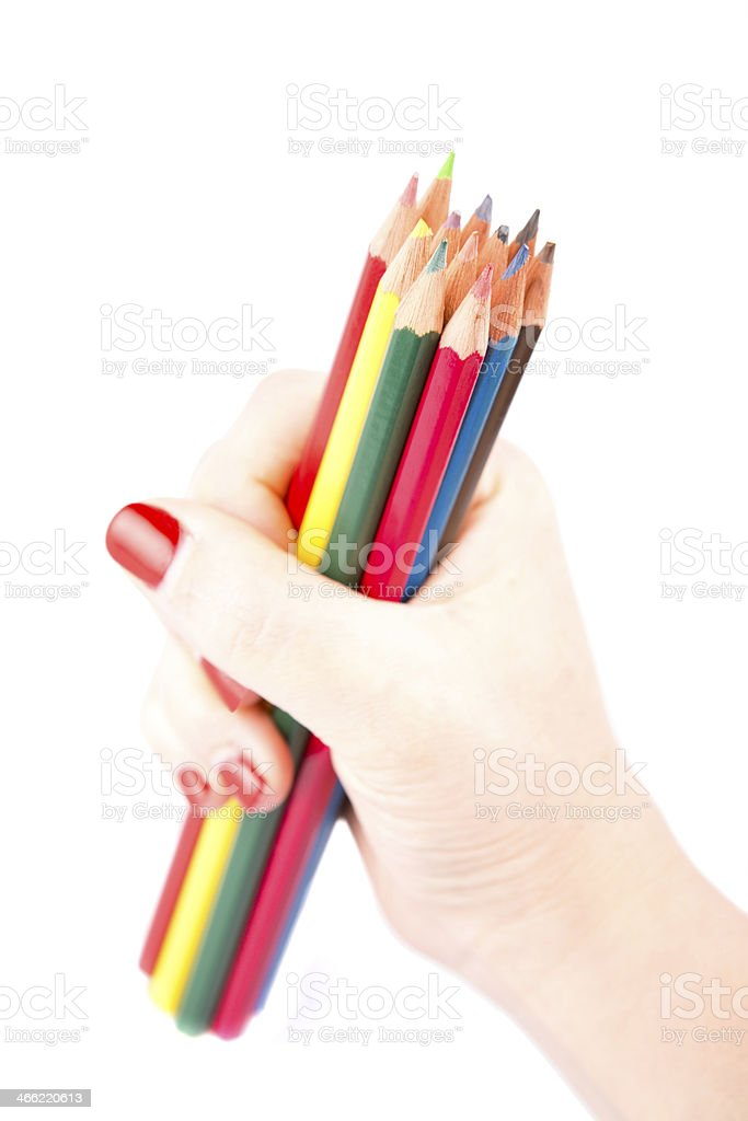 Hand holding colored pencils isolated royalty-free stock photo