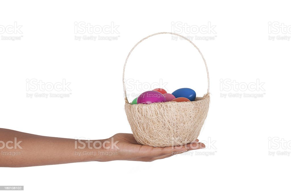 Hand holding colorful Easter eggs in the basket royalty-free stock photo