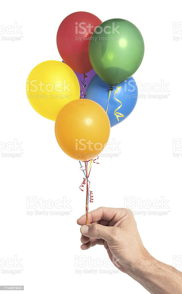 Hand holding colorful helium balloons isolated on white background royalty-free stock photo