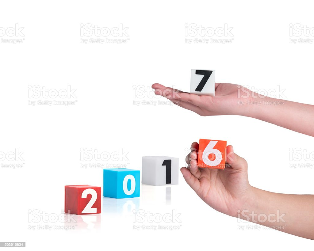 hand holding colorful plastic of year numbers stock photo