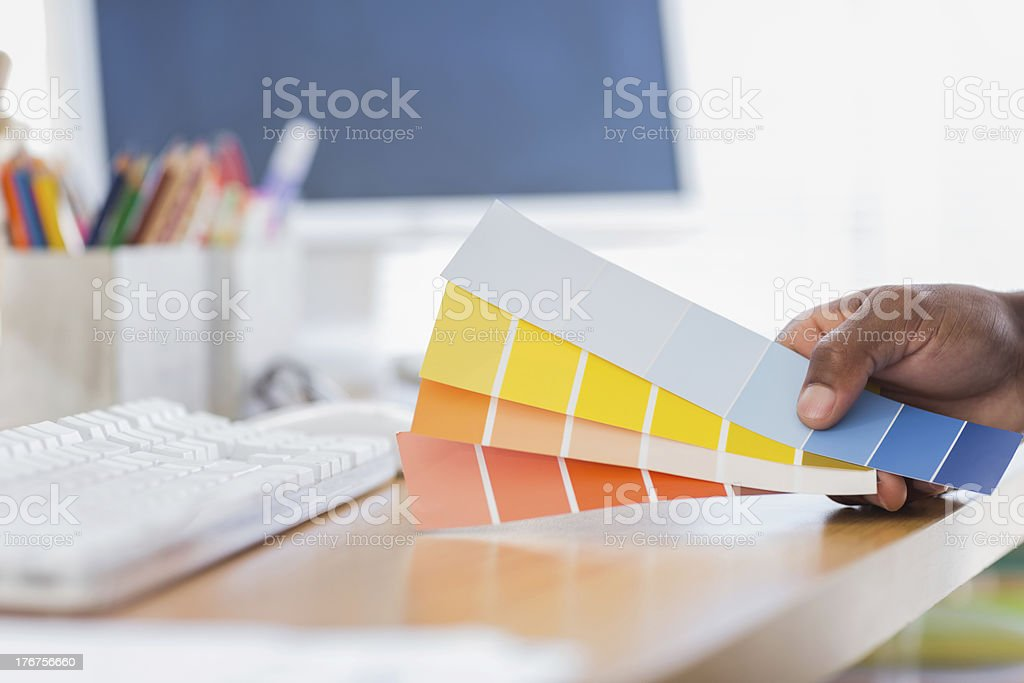Hand holding colour charts in a modern office royalty-free stock photo