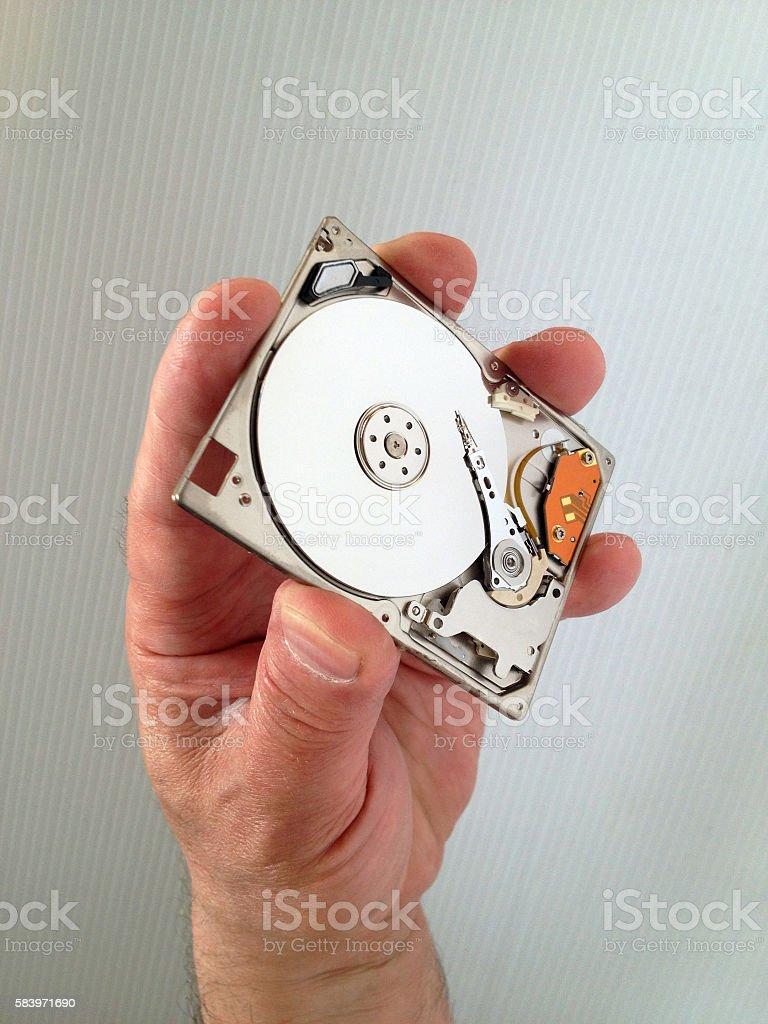Hand holding computer hard drive stock photo