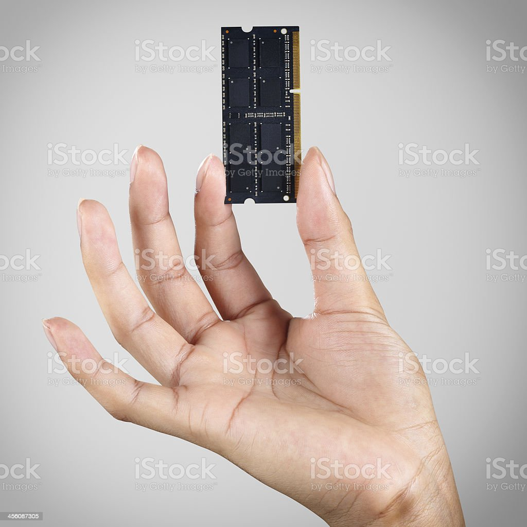 Hand holding computer memory stock photo