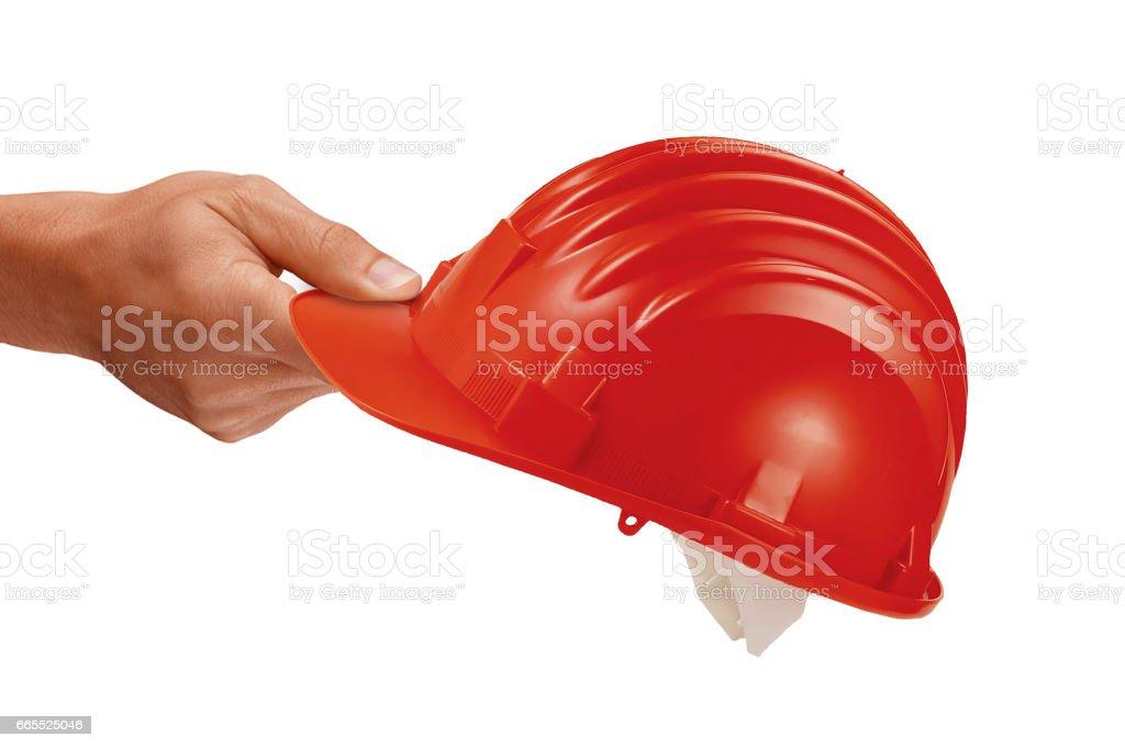 hand holding construction helmet stock photo
