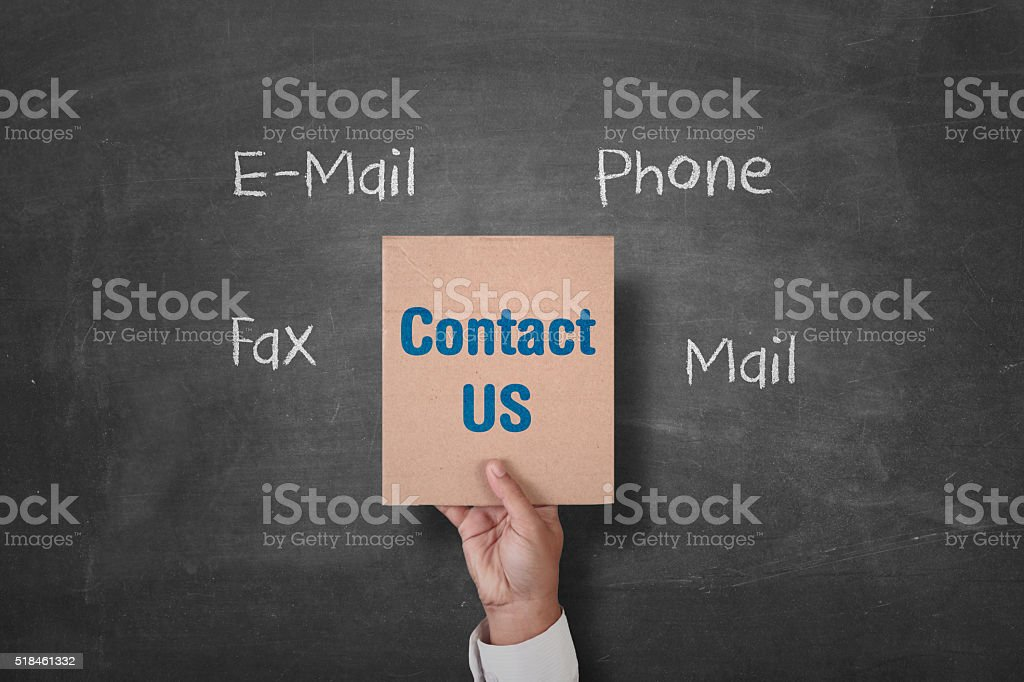 Hand holding contact us placard stock photo