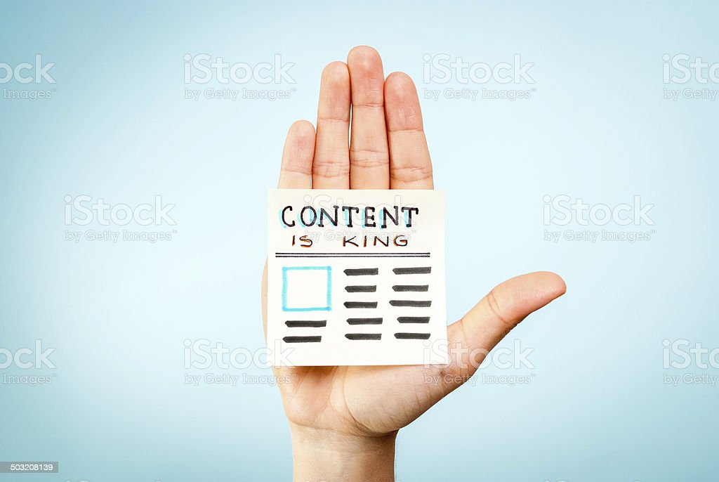 Hand holding content is king message. Content marketing concept stock photo