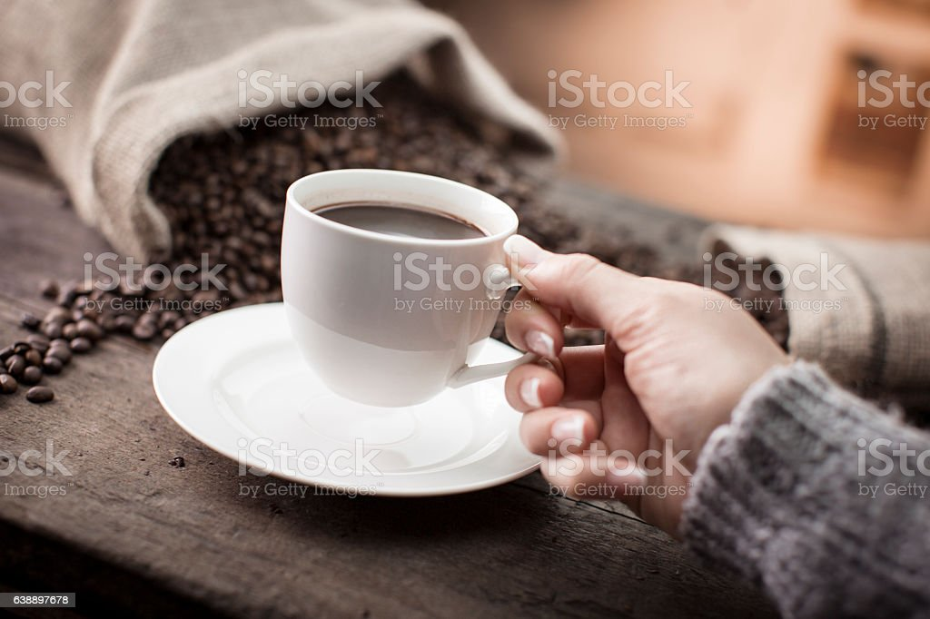Hand holding cup of coffee stock photo