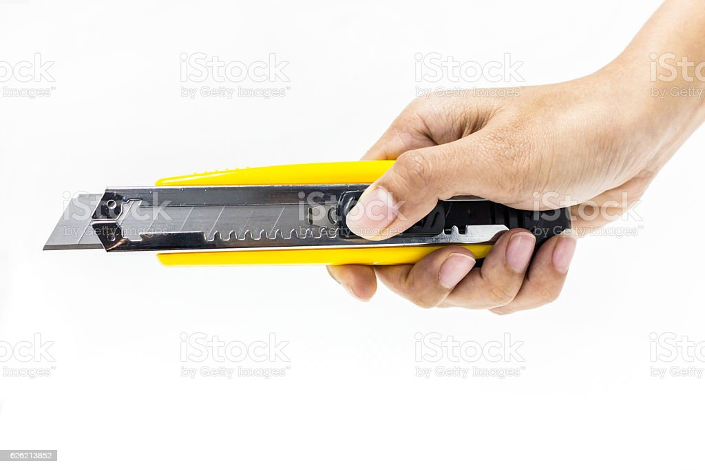 hand holding cutter, sharped knife royalty-free stock photo