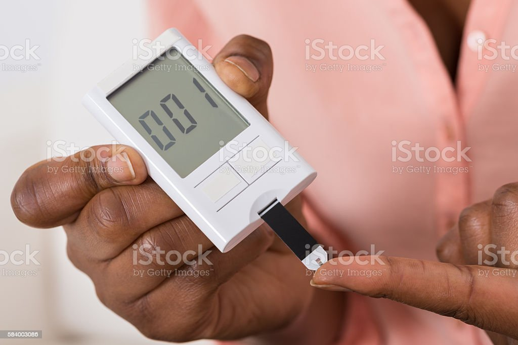 Hand Holding Device For Measuring Blood Sugar stock photo