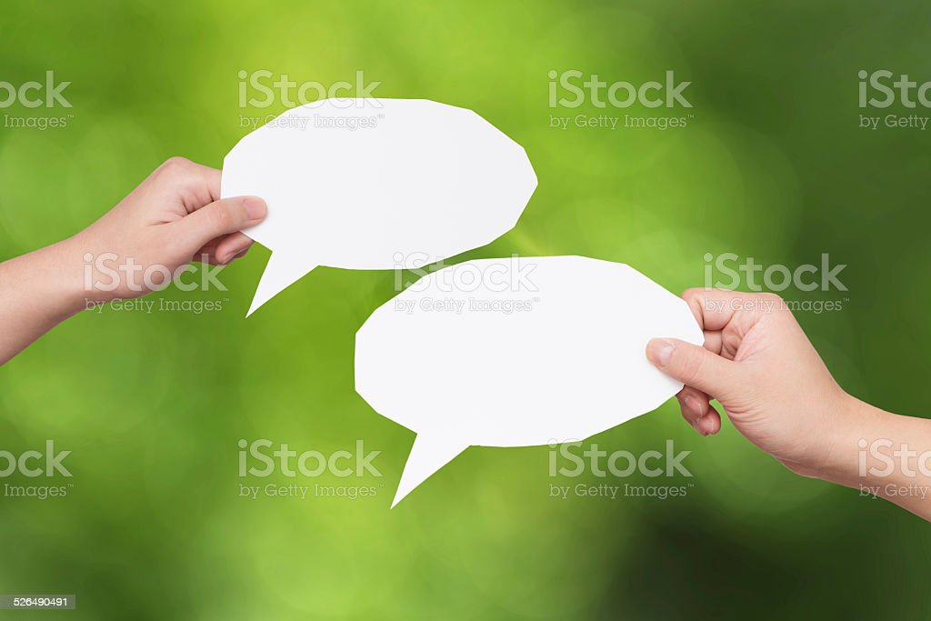hand holding dialogue bubble with blur motion background stock photo