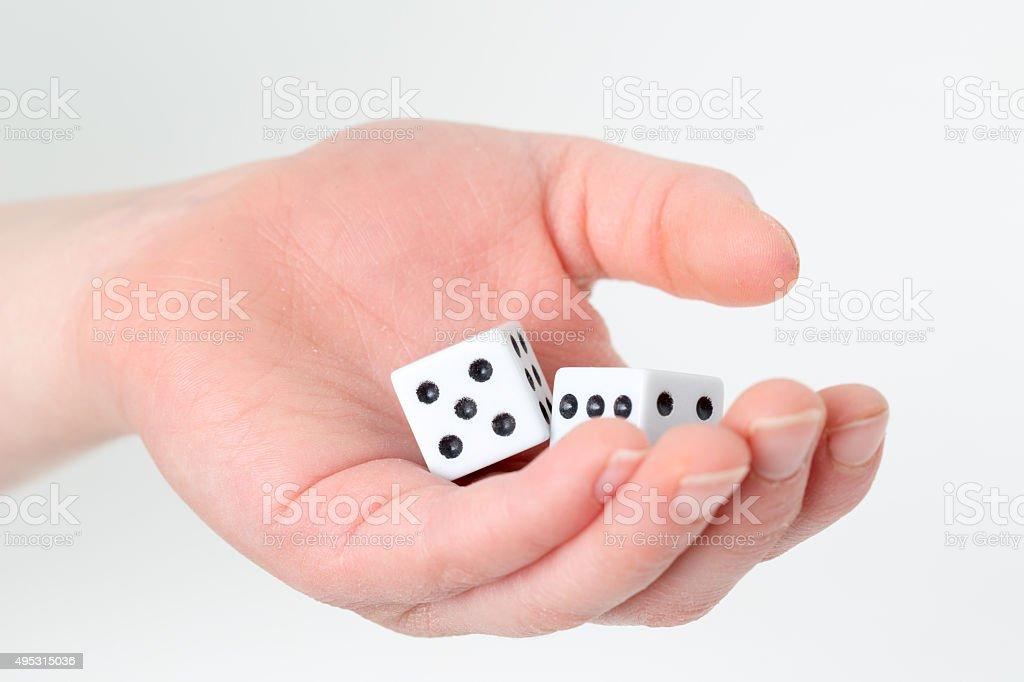 Hand holding dice stock photo