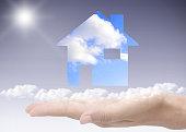 Hand holding dream home