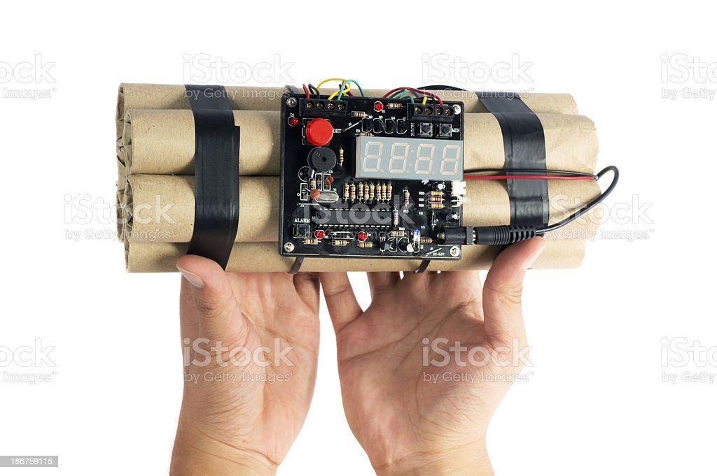 Hand Holding Dynamite Bomb royalty-free stock photo