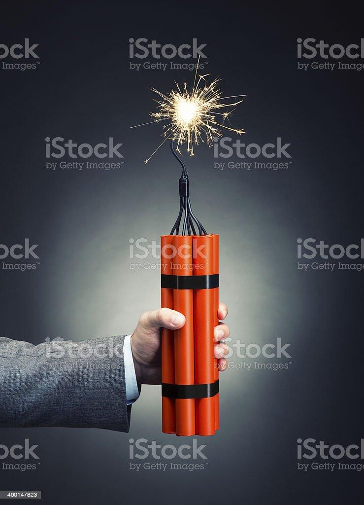 Hand holding dynamite stock photo