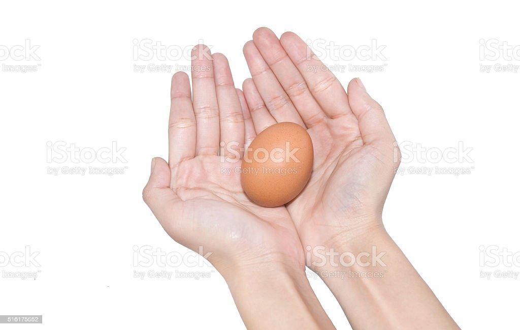 Mano agarrando huevos de Pascua día foto de stock libre de derechos