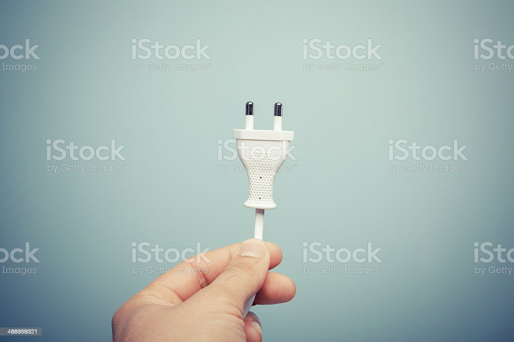 Hand holding electric plug stock photo