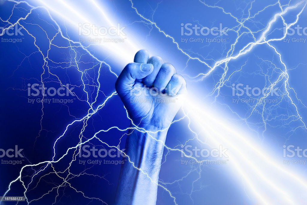 Hand holding electricity beam with rays surrounding stock photo