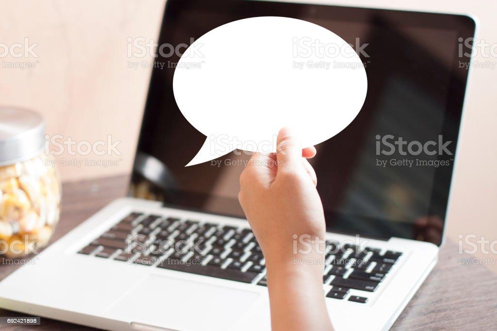 Hand Holding Empty White Speech Bubble Template stock photo