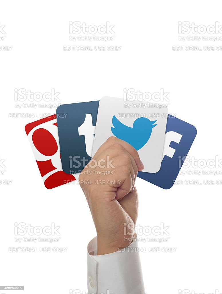 hand holding facebook, google, tumblr, twitter icons on white background stock photo