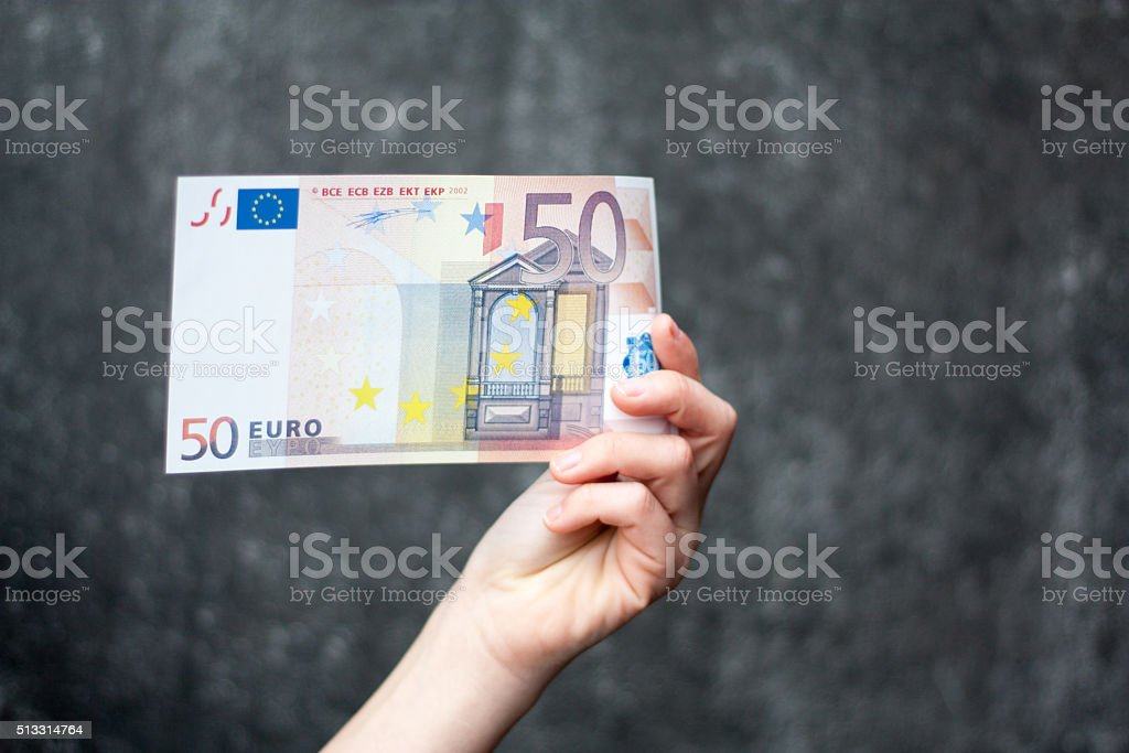 Hand holding fifty euro note stock photo